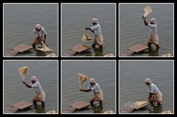 Dhobi-wallah, blanchisseur à l'action dans les eaux brunes du Gange